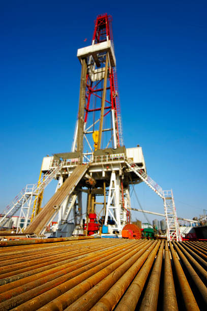 Drill pipe with drilling rig stock photo