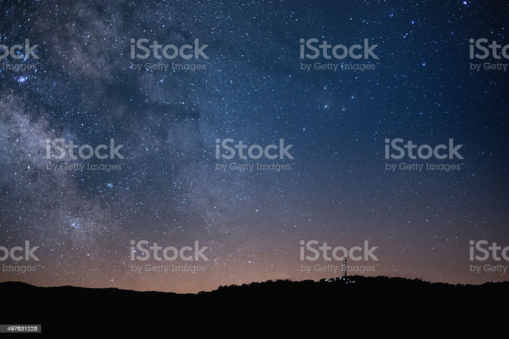 Drill Rig Fracking Operaton Silhouette Under Stars and Milky Way stock photo