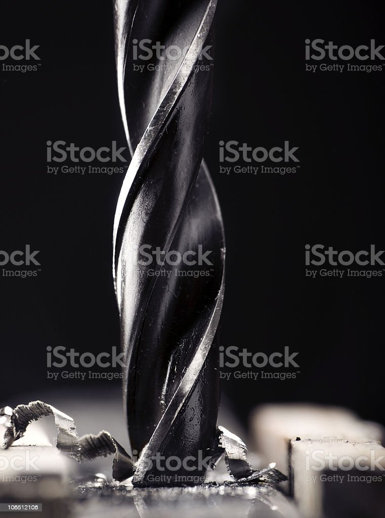 Drill tearing away at the metal beneath it upon contact royalty-free stock photo