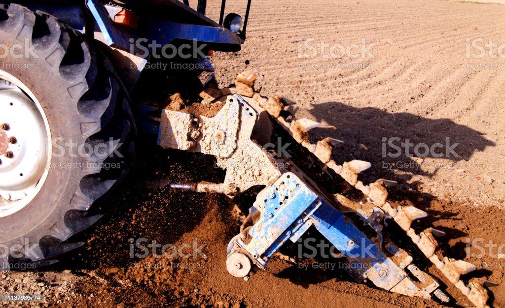 Drill using tractor & machine in the field Drill using tractor & machine in the field Active Lifestyle Stock Photo