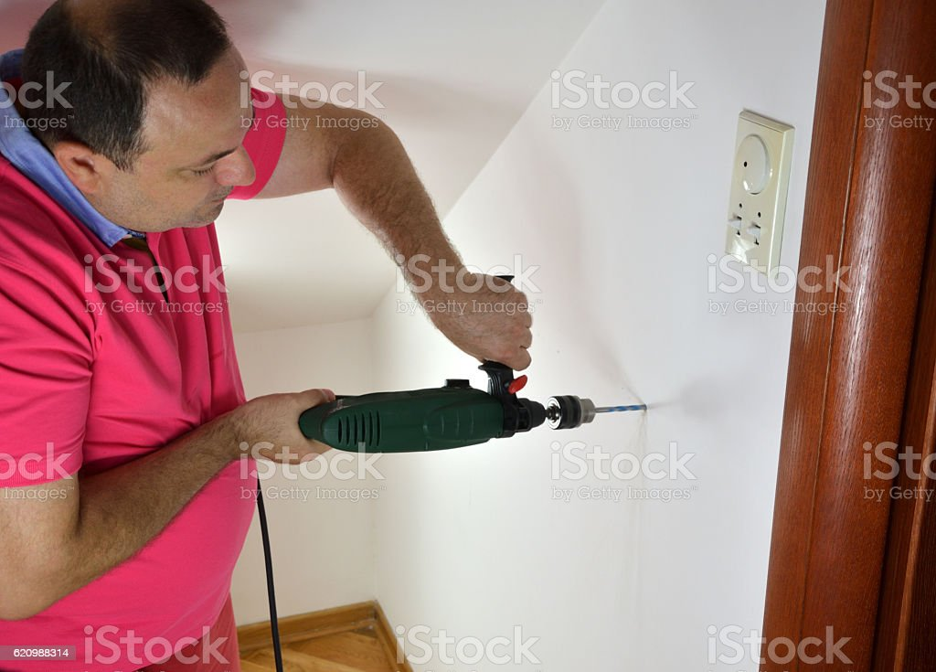 Drilling a Hole in a Wall foto royalty-free