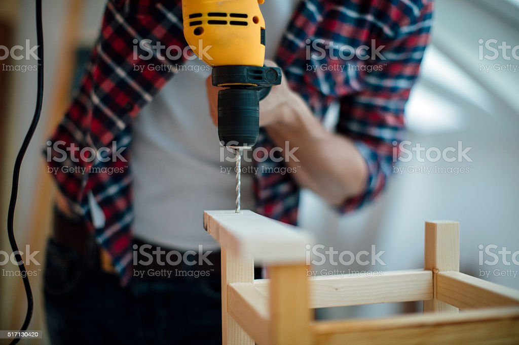Drilling a plank. stock photo