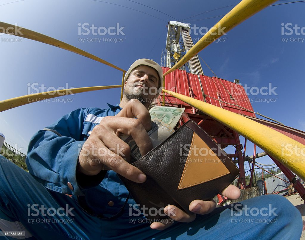 Drilling engineer counting money he earned oh this rig stock photo