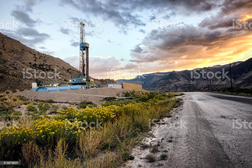 Drilling Fracking Rig at Sunrise stock photo