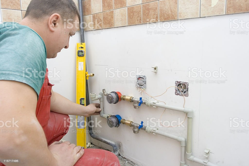 Drilling holes for the fixing water pipes royalty-free stock photo