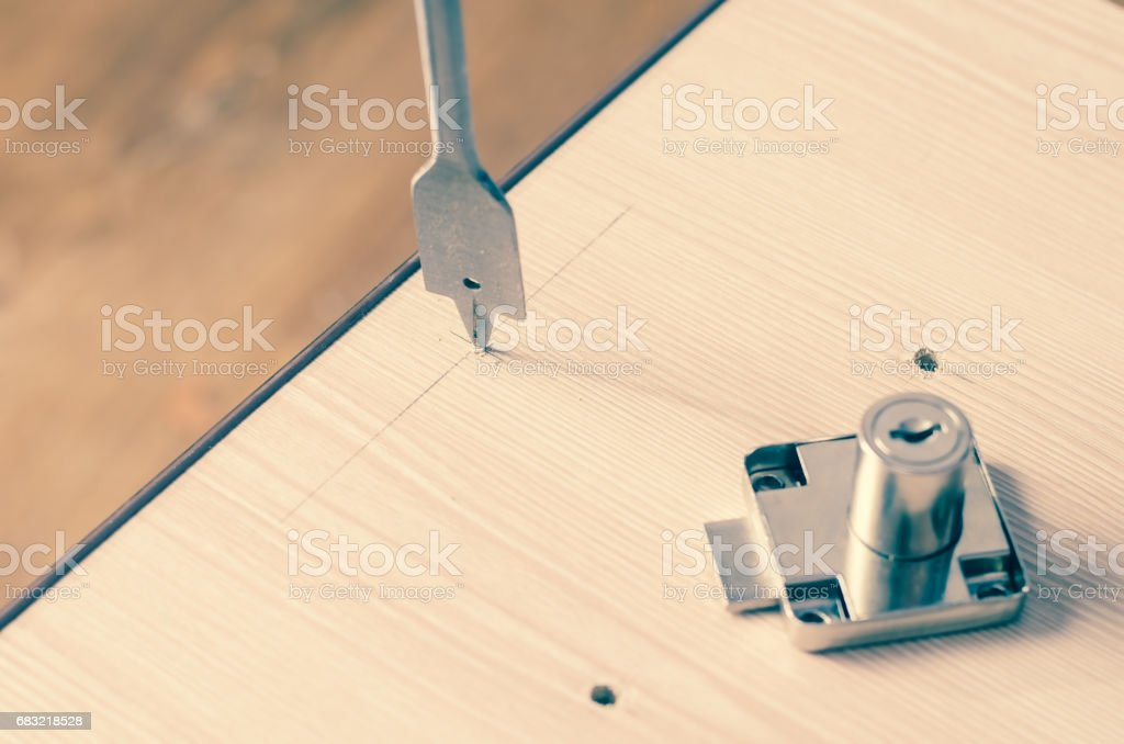 Drilling holes in a wooden block royalty-free 스톡 사진