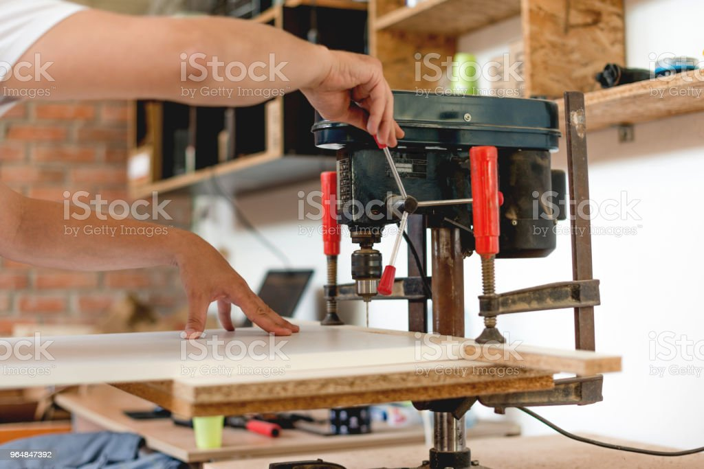 Drilling holes in the plank royalty-free stock photo