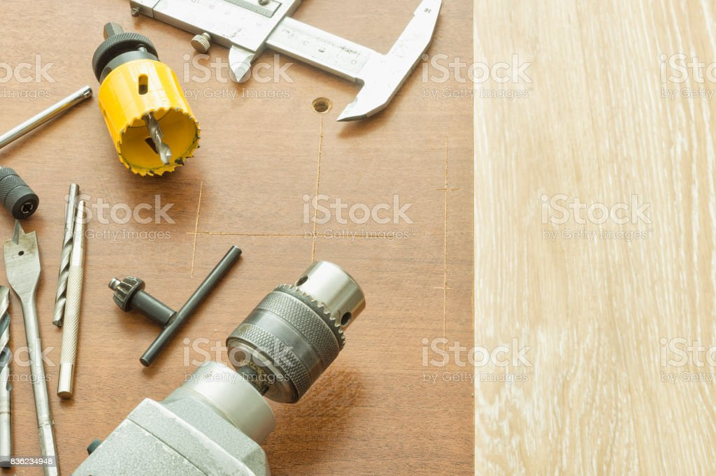 Drilling large holes with hand electrical tools stock photo