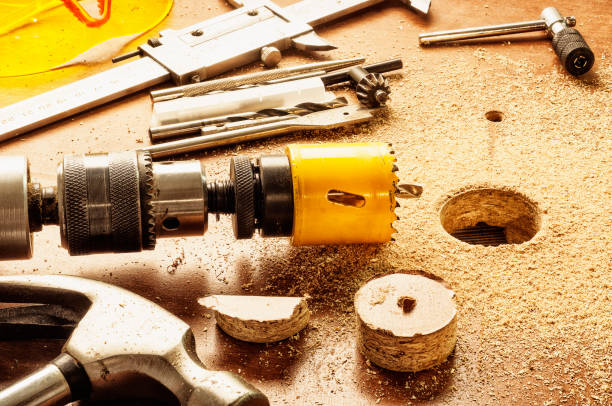 Drilling large holes with the aid of electrical instruments stock photo