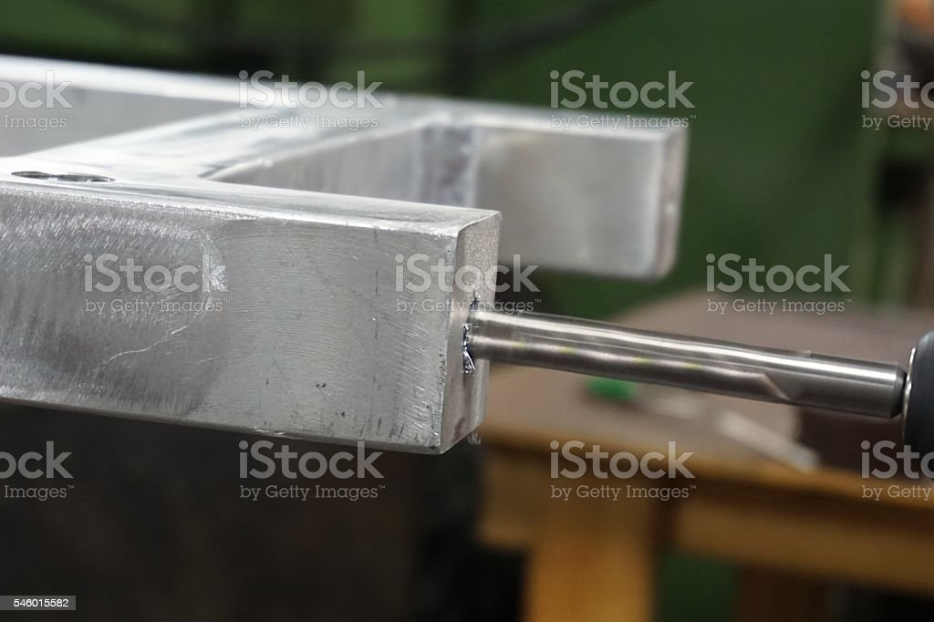 drilling metal tube stock photo