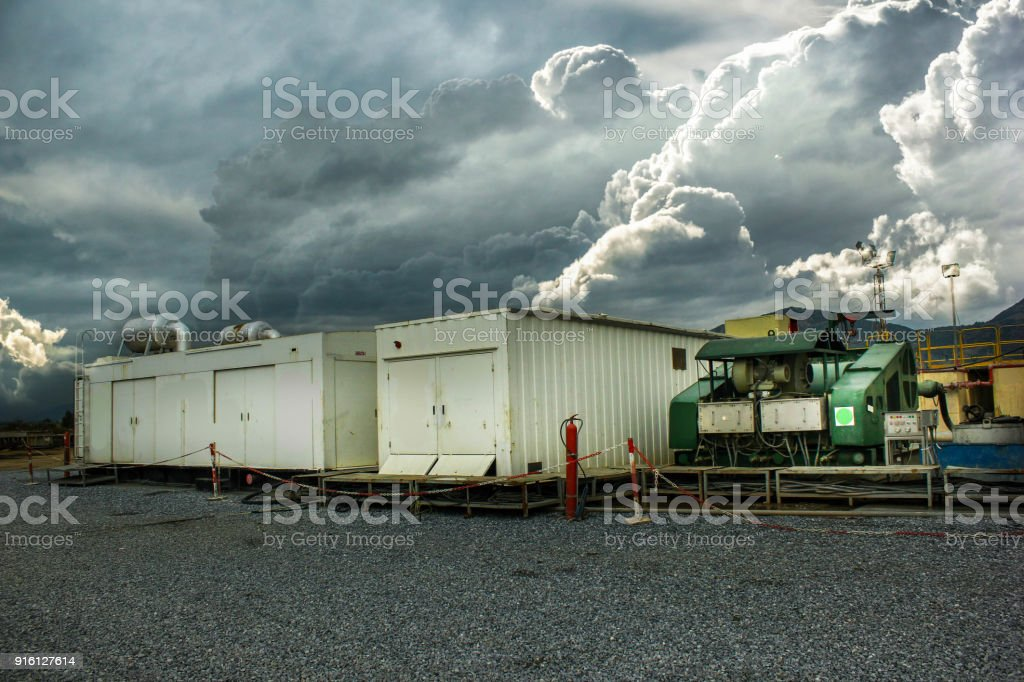 Drilling on the geothermal well platform and Equipments on a cloudy day stock photo