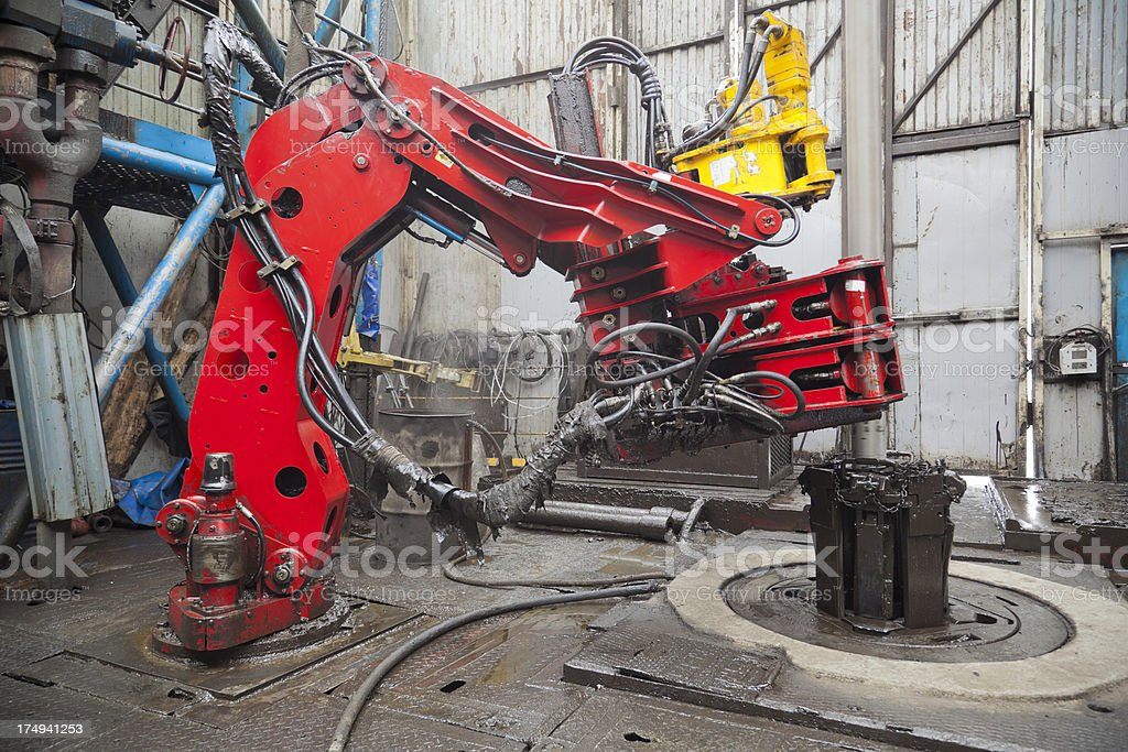 Drilling rig floor with iron roughneck stock photo