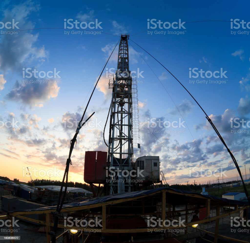 Drilling rig silhouette during beatifull sunset royalty-free stock photo