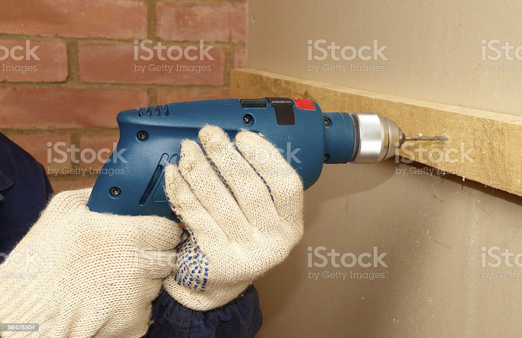 Drilling the wood royalty-free stock photo