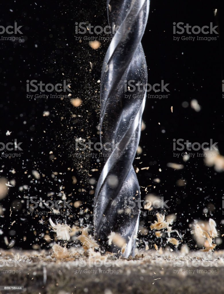 Drilling wooden plank stock photo