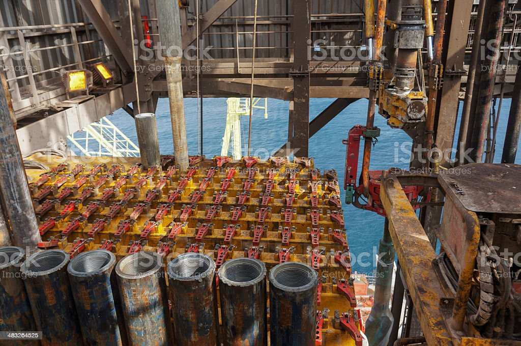 drillpipe in oil rig drilling derrick royalty-free stock photo
