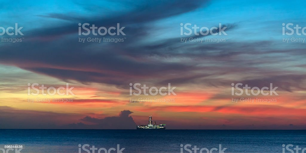 Drillship illuminated under amazing colorful twilight skyscape stock photo
