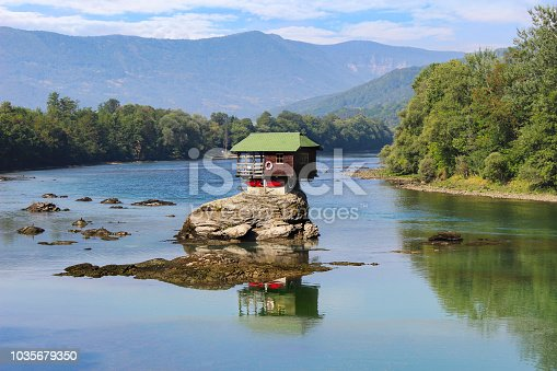 Colorful little house on the rock on the middle of the Drina river in west Serbia, in Bajina Basta, one of the most popular attractions of this area