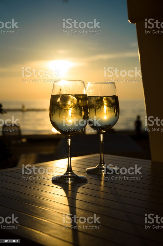 drink and the sunset backlight stock photo