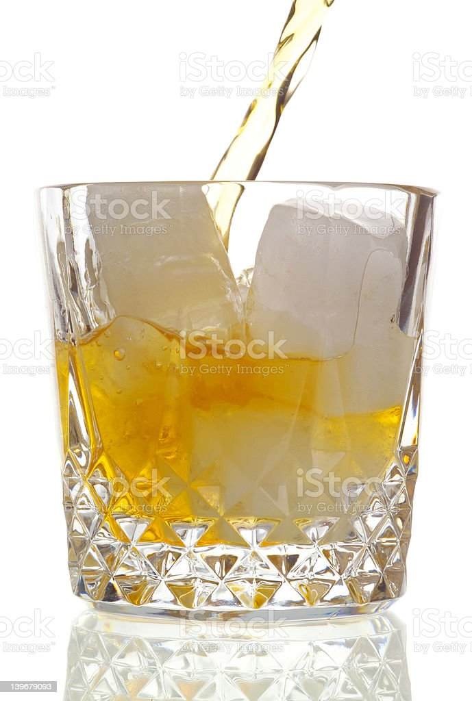 Drink being poured, high-key background royalty-free stock photo