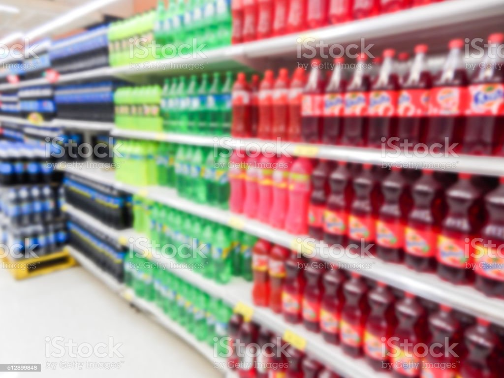 Drink bottles on display on shelves in a supermarket stock photo