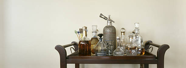 Drink Cart with Decanters and Bottles stock photo