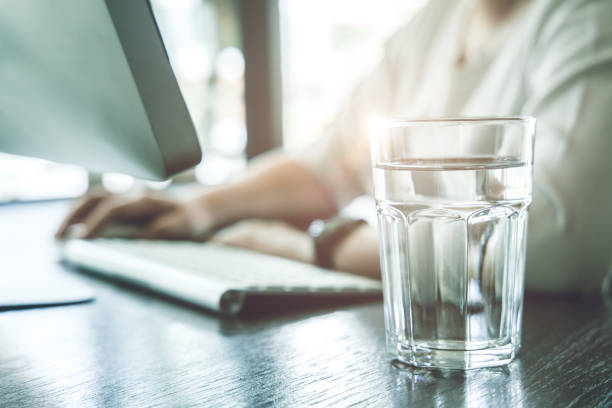 Drink clean room temperature water during working time for healthy and stay hydrated at work. Drink clean room temperature water during working time for healthy and stay hydrated at work. stay hydrated stock pictures, royalty-free photos & images