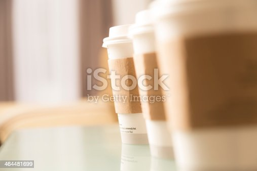 Three cups of coffee sitting on a glass top office table or cafe.  Catering for office meeting or drinks in coffee shop.