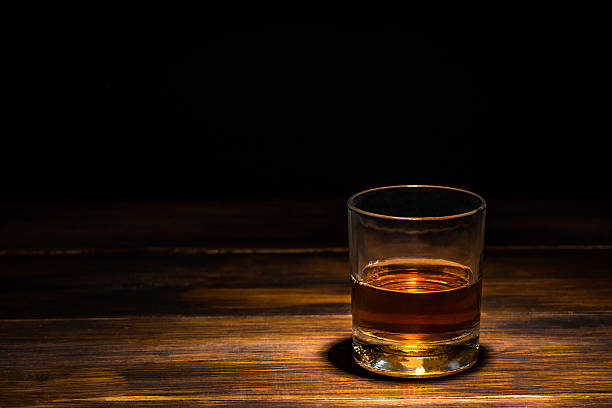 drink on a wooden table - whiskey stock photos and pictures