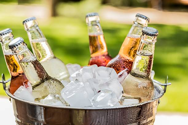 Drink Beverage Bottles with Ice in a Bucket cooler container stock pictures, royalty-free photos & images