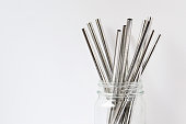 Stainless steel straws in glass jar. Copy space.