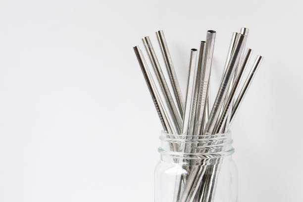 Drink up Stainless steel straws in glass jar. Copy space. drinking straw stock pictures, royalty-free photos & images