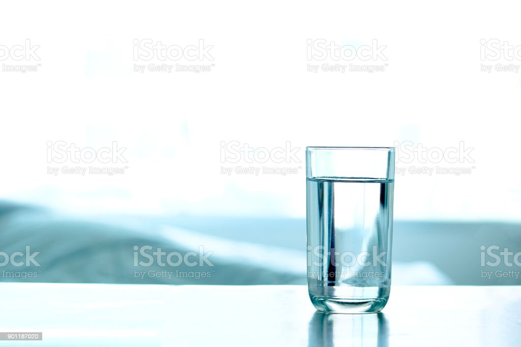 Drink Water. Pure water in the glass on the table. Health concept