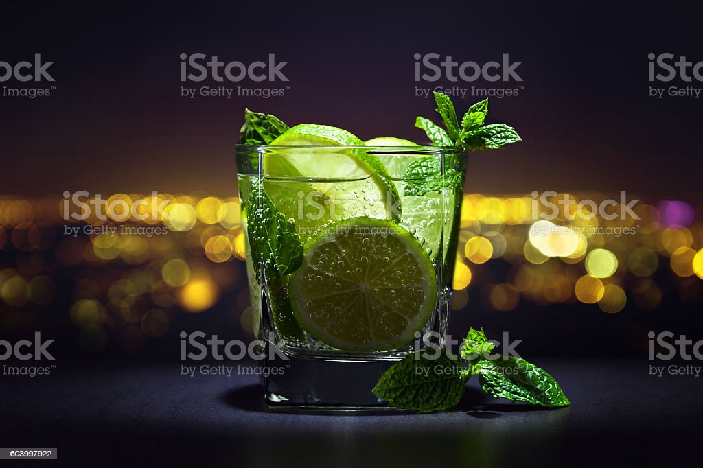 Drink with lime and peppermint leaves stock photo