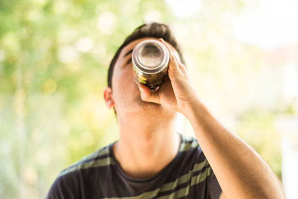 Drinking a can stock photo