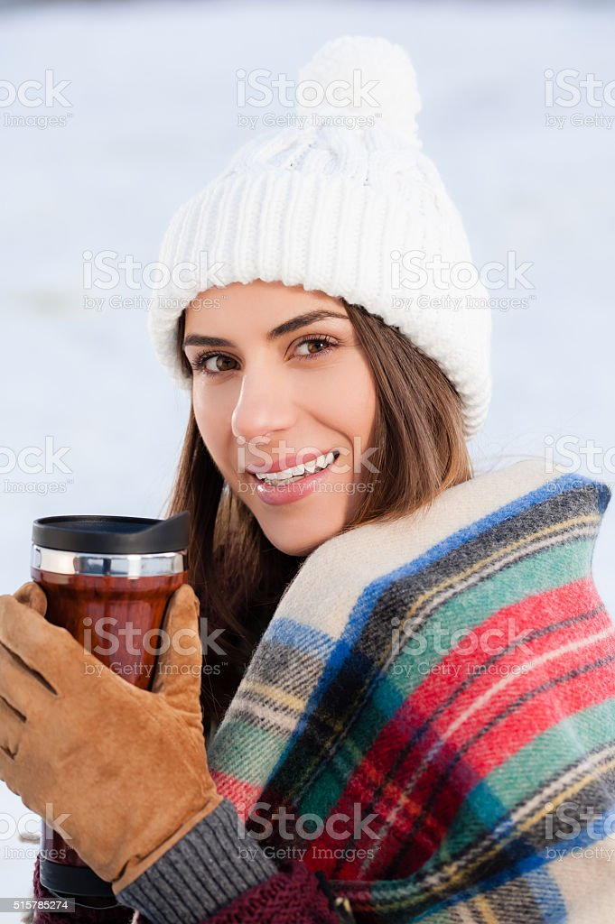 Drinking a hot tea from thermos stock photo