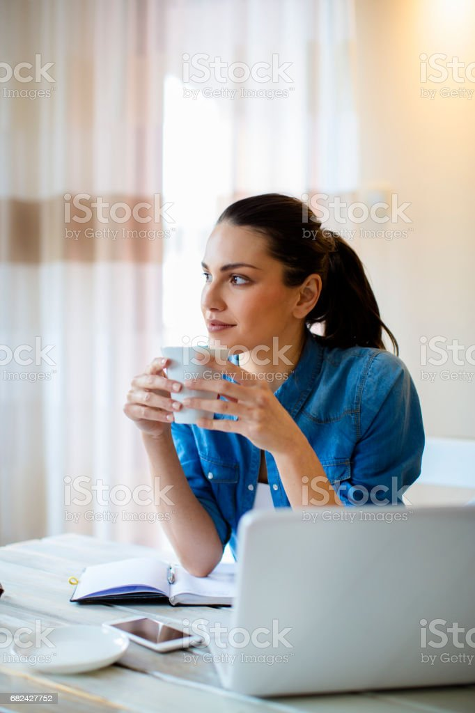 Drinking afternoon coffe and working royalty-free stock photo