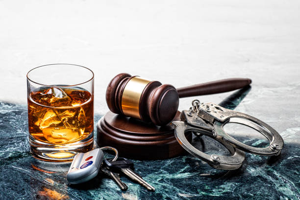 Drinking and Driving Handcuffs and Gavel on Marble Background stock photo