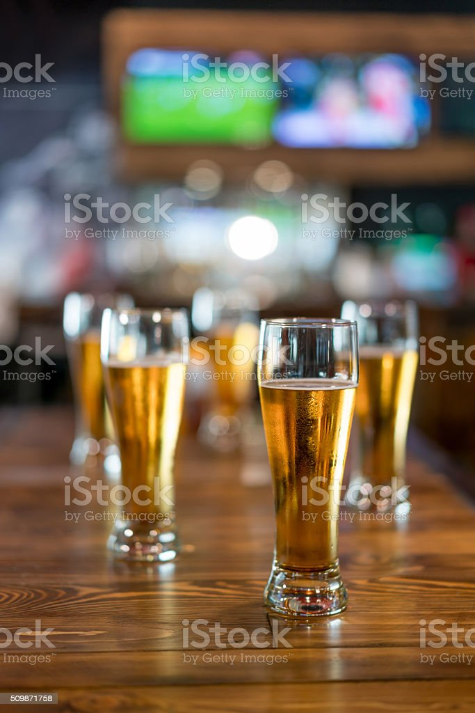 Drinking beer at a sports bar stock photo