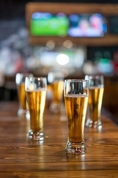 Drinking beer at a sports bar stock photo
