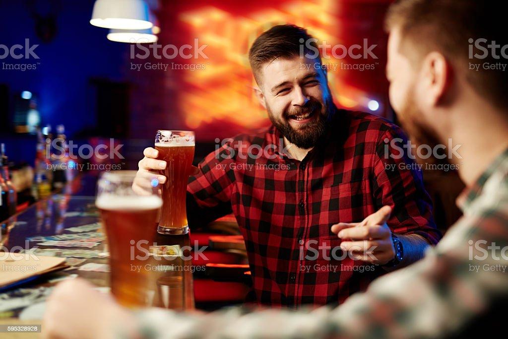 Drinking beer at bar stock photo