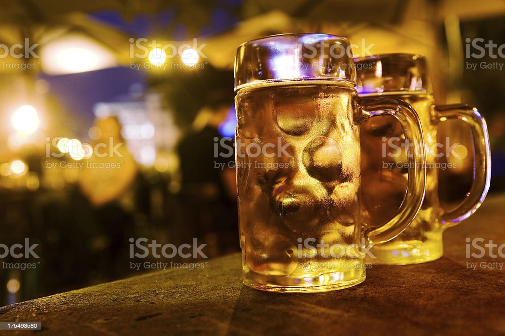 Drinking beer at night stock photo