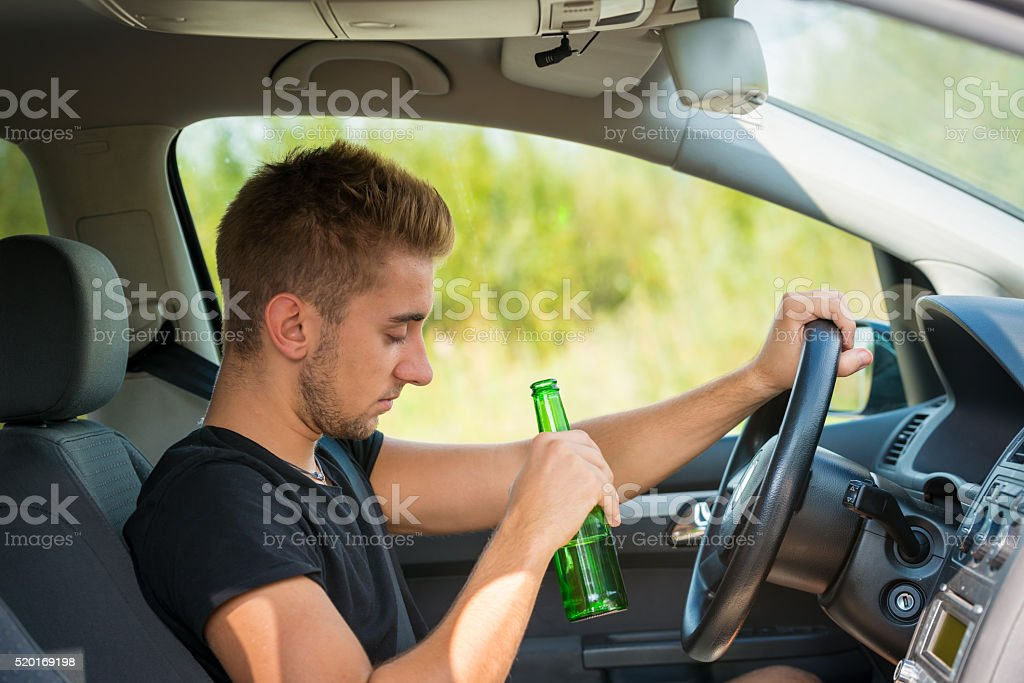 Drinking Beer while Driving a Car stock photo