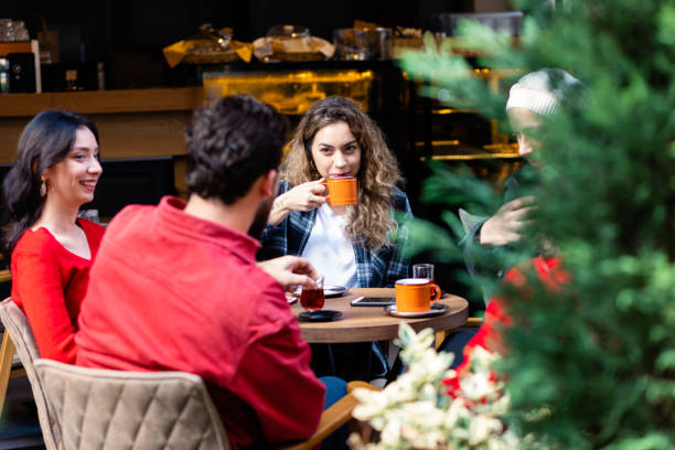 Drinking cappuccino at coffee restaurant . stock photo
