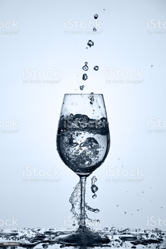 Drinking Clean Water With Water Bubbles Pouring In Wineglass
