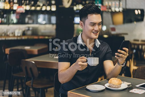 824167622istockphoto Drinking coffee and texting at cafe 1026807078