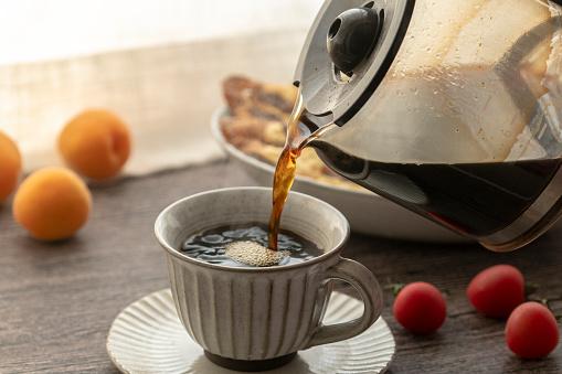 drinking coffee at breakfast