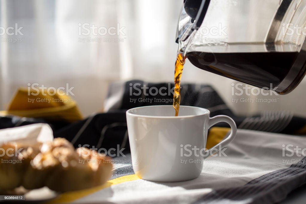 drinking coffee at breakfast stock photo
