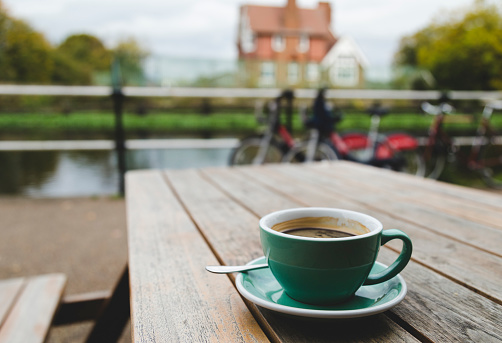 Drinking Coffee Near The River
