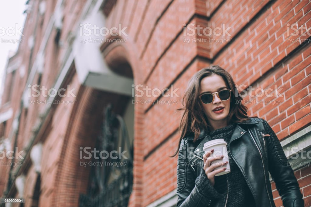 Drinking coffee to go stock photo